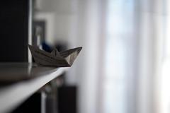 """Marginal"" (helmet13) Tags: window backlight table raw bokeh curtain shelf simplicity conceptual selectivefocus paperboat 100faves peaceaward heartaward world100f d800e"