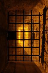 Behind the door (Fabien Husslein) Tags: city light shadow orange france monument night medieval ombre des age lumiere pont porte grille middle fortification chateau lorraine fortress nuit ville metz vieille forteresse moselle historique acces seille fortifie allemands