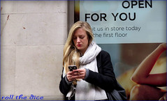 `1584 (roll the dice) Tags: uk portrait england people urban signs sexy london art classic girl westminster fashion mobile scarf shopping funny pretty phone natural candid talk stranger blonde unknown shops oxfordstreet w1 westend unaware londonist