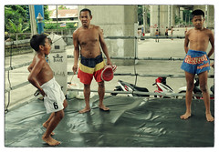 Muay Thai Kids - Growing up in the Ring (Mio Cade) Tags: boy art sport training children thailand kid pain fight hurt asia child exercise martialart bangkok documentary ring sweat kickboxing reportage muaythai discipline
