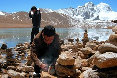 Gurudongmar Lake..... A Prayer for the Departed Soul (pallab seth) Tags: travel sky people india mountain snow cold tourism digital landscape religious nikon asia tour place wind flag culture peak buddhism tibet coolpix ritual custom hinduism sikkim prayerflag p3 northsikkim nikoncoolpixp3 nikonp3 prayerofferings prayingflags tibetianplateau gurudongmarlake indianlandscapephotography highestfreshwaterlakes