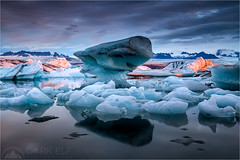 Ice World (Maciek Gornisiewicz) Tags: morning ice clouds sunrise canon landscape photography dawn iceland europe lagoon glacier filter iceberg maciek jokulsarlon iceworld 2015 darkelf 24105mm gornisiewicz 5diii