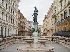 Mariahilfer Straße, Vienna (zsonemes) Tags: vienna wien travel travelling statue pen lite austria spring europe cloudy young olympus traveller amateur mariahilfer zd strase epl5