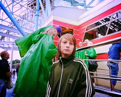 Green Age (Steve Lundqvist) Tags: park street boy summer portrait people guy green rain youth amusement kid child sweden stockholm outdoor young streetphotography hood lunapark sweatshirt adidas raincoat stoccolma rollercoast hooded sportswear svezia grunalund sveige