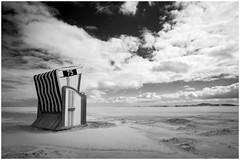 Strandkorb (tosch_fotografie) Tags: cloud beach clouds strand island deutschland blackwhite sand meer minolta sony wolken norderney insel 24mm 75 a7 strandkorb rokkor schwarzweis