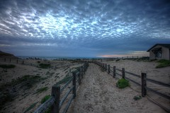 The Ocean is Calling (KC Mike D.) Tags: ocean sunset sea beach clouds fence fire sand waves path campfire land puffy sanctuary firepit protected
