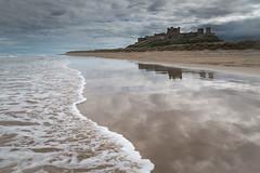 Bamburgh Castle (Duncan Herring) Tags: seascape castle beach clouds landscape waves dunes places reflected northumberland coastal northumbria northsea foam northeast refections wetsand bamburghcastle neengland ef24105mmf4lusm canon5dmarkiii duncanherring