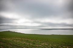 (Raphs) Tags: ocean light sea sun green water field clouds denmark grey coast view cloudy hill fv5 calm balticsea zealand shore rays danmark raphs emptyspace sjlland breakingthrough stersen klinteby canoneos70d canonefs1018mmf4556isstm