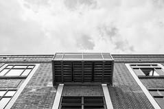 DSC_0056 (Florian Rathcke) Tags: sky blackandwhite bw cloud sun building monochrome architecture harbor harbour geometry hamburg hafen altona altonaerkaispeicher