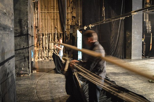 Akhmet and another stagehand hang backdrop curtains at the Mayakovsky Theater