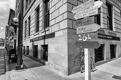StPaulArtCrawl2016_46316-.jpg (Mully410 * Images) Tags: street blackandwhite brick monochrome sign mailbox streetsign stpaul sidewalk 2016 artcrawl northwesternbuilding niksilverefexpro