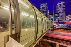 Crossrail, Docklands, London, UK (davidgutierrez.co.uk) Tags: street city uk longexposure greatbritain nightphotography travel blue england people urban streets color colour building london art colors beautiful station architecture night train buildings photography lights twilight nikon europe poplar cityscape colours photographer footbridge unitedkingdom britain dusk vibrant capital arts pedestrian tunnel structure le londres docklands lighttrails bluehour colourful canarywharf londra hsbc dlr eastlondon docklandslightrailway canarywharftower  towerhamlets londyn ultrawideangle    d810 streaminglights nikond810 1424mm davidgutierrez londonphotographer afsnikkor1424mmf28ged davidgutierrezphotography footbridgetunnel