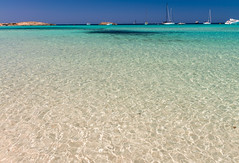 Ses Illetes Beach in Formentera, Spain (Travelbusy.com) Tags: ocean blue sea summer italy white tourism beach nature water horizontal relax landscape islands coast spain sand scenery holidays mediterranean natural ses scenic scene tourist spanish destination summertime picturesque vacations formentera balearic illetes