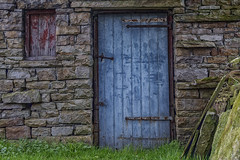 The Old Blue Door (gobgod) Tags: door abstract building texture abandoned architecture outdoor stonework rustic faded