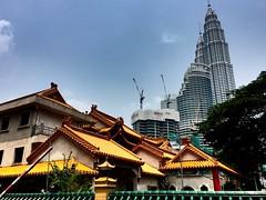 Ancient and Modern (Anil Jethwa) Tags: blue hot sunshine temple skies petronas towers chinese twin incense towering iphone
