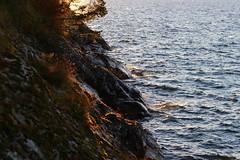 Half & half (J. Roseen) Tags: sunset sunlight lake water rocks outdoor vatten vttern solnedgng sj klippor jrgn rosn solskeneos7dmkii