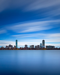 Clouds over Back Bay Boston Skyline and Charles River on Beautiful Blue Afternoon (Greg DuBois - Sponsored by LEE Filters) Tags: city longexposure blue cambridge sky urban usa cloud sunlight seascape motion reflection tower water boston skyline clouds canon buildings photography daylight photo movement colorful downtown day cityscape afternoon skyscrapers unitedstates cloudy photos massachusetts charlesriver towers stock smooth newengland surreal sunny wideangle wallart stretch minimal prints daytime waterblur hancock broad northeast prudential backbay eastcoast waterscape 6d leefilters superstopper gregdubois