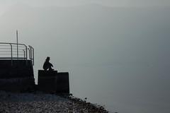 Gianluca sul molo (Marta Panzeri) Tags: italy lake como water contrast lago pier friend italia low lombardia molo lecco contemplation amico contrasto contemplazione