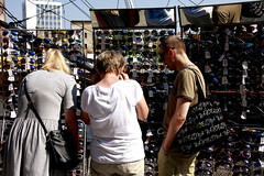 Life is choosing (Giangaleazzo) Tags: life city sun sunglasses canon glasses three women market poland charm eod choice tre mercato gdansk polonia peple choosing occhiali scelta scegliere 40d