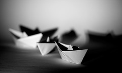 Set sail to the unknown... (Michael Kalognomos) Tags: bw white black monochrome canon paper eos boat ship shadows dof indoor shade sail 24105 70d