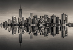 Manhattan Reflection (King Grecko) Tags: usa newyork reflection water skyline america skyscraper photoshop canon buildings manhattan landmarks wtc chrysler bigapple businessdistrict