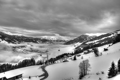 Up above the clouds (adam_moralee) Tags: above trees shadow sky bw white snow black adam nature up clouds dark lens landscape austria blackwhite am nikon skies valley multiple tamron hdr zel exposures 18200mm skie zill moralee d7000 adammoralee