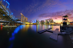Ignition (night86mare) Tags: city bridge sunset skyline museum marina way bay twilight singapore glow cityscape fujifilm helix sands afterglow shenton artscience xt1