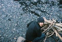 Sam Starts a Bonfire (Rachael.Robinson) Tags: wood winter canada man color film 35mm island sticks bonfire jacket fujifilm bearded campobello