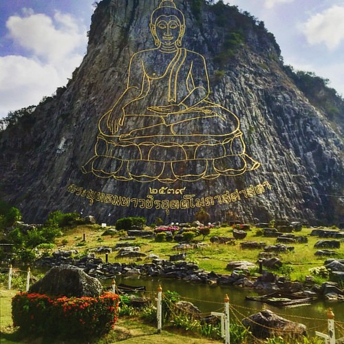 "Once upon a time, someone looked up at this giant rock face and thought ""there should be a ginormous gold outline of the Buddhas image on there"" and he went home and told his wife.  She probably told him he was crazy.  But there it is now.  People are ama"