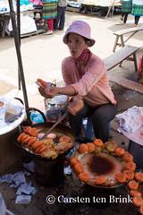 Take one (10b travelling) Tags: food woman asian asia asien southeastasia vietnamese northwest market stall vietnam valley snack asie northern streetfood sapa laocai indochine indochina bacha 2015 bch locai otherkeywords tenbrink muonghoa carstentenbrink genericplaces iptcbasic 10btravelling
