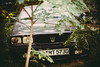 Jungle Crown (Sator Arepo) Tags: leica trees berlin classic car germany 50mm weeds rangefinder f1 brush hidden jungle camouflage crown noctilux maserati m9 biturbo leicam9