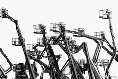 urban safari in a land of steel and hydraulics (lunaryuna (off to Iceland for 2 weeks)) Tags: bw blackwhite funny monochromatic cranes highkey lunaryuna platforms lifts urbansafari