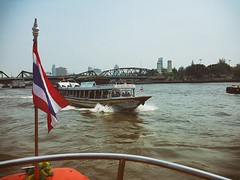 Two Ferry Boats (shazell212) Tags: bridge ferry skyline thailand riverside bangkok flag chaophrayariver
