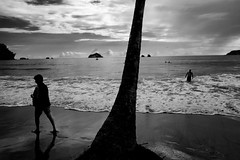 Last swim (halifaxlight) Tags: sea bw tree beach clouds islands costarica surf silhouettes pacificocean swimmers figures manuelantonio