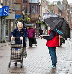 106/366 Wealth Management? - 366 Project 2 - 2016 (dorsetpeach) Tags: england wet rain shop umbrella dorset 365 dorchester shopper bigissue 2016 bigissueseller 366 aphotoadayforayear 366project second365project