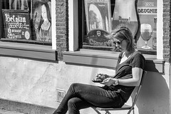 She had a breakfast on a beautiful sunday morning in Delft and I was also interested in the Belgian Beer... (fnoothout) Tags: street girl breakfast blackwhite streetphotography nikond7100