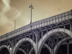 West Side Highway (Explore, April 26) (Mildred Alpern) Tags: outdoors highway pipes arches route infrared railings girders skyclouds lampposts steelarchitecture