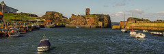 Dunbar Castle Ruin and Harbour (Brian Travelling) Tags: uk greatbritain blue castle water stone boats harbor scotland boat pentax unitedkingdom harbour ruin bluesky historic northsea historical dunbar 31 borders pentaxkr