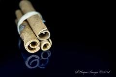 Cinnamon (scotty NEX harper) Tags: wood black reflection sticks cinnamon sony plastic curly string curled swirl nex7