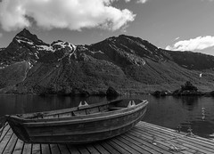 The rowboat (Beate Nilsen) Tags: blackandwhite mountain water monochrome norway landscape boat blw outdoor rowboat fjord nordnorge bod kjerringy northernorway