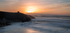 The Sound Of Silent (MANUELup) Tags: ocean light sunset red sea sky panorama orange cliff cloud sun sunlight seascape mountains colour reflection tower castle beach rock spain rocks cloudy north peaceful wave calm colourful cantabria tagle