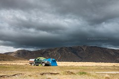 Four wheel drive vehicle and tent with dramatic cloudy sky (hueymilunz) Tags: travel sky mountain clouds dark landscape nz marlborough newzealandtransition