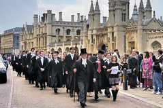 University graduation procession in front of King's College on King's Parade, Cambridge, England (edk7) Tags: street city uk cambridge chimney england sky people urban sculpture woman cloud man building male architecture female person student cityscape arch pavement stonecarving mortarboard spire kingscollege column gown 2010 kingsparade baywindow oldstructure orielwindow universityofcambridge gradeilisted nikond300 edk7 frontcourtscreengothicrevival wilkinsbuildingenglishrenaissancerevival williamwilkins1824 universitygraduationprocession