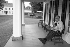 Porch Talk (peterkelly) Tags: bw usa house newyork man window digital bench beard glasses us chair sitting unitedstates unitedstatesofamerica pillar porch shutters northamerica column eyeglasses cooperstown thefarmersmuseum