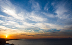 Any Way The Wind Blows (DobingDesign) Tags: ocean sunset sea sky cloud sun beach nature water beauty clouds landscape coast seaside colours natural cloudy outdoor dusk horizon shoreline bluesky land coastline colourful curve swirly redyellowblue chaoticclouds