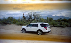 Olympus Trip 500, Kodak Max 400 (K e v i n) Tags: arizona southwest film analog cacti 35mm desert az scan vehicle dirtroad kodakmax400 sonorandesert marana santacatalinamountains southernarizona olympustrip500 epsonv500