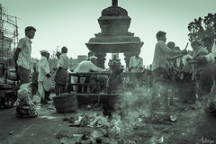 People doing pooja infront of a Nandi statue in Srisailam, Andhrapradesh, India (Aditya Chandra) Tags: travel monochrome architecture temple divine pooja nandi shiva hindu andhrapradesh srisailam kurnool