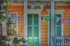 shotgun charm (jeneksmith) Tags: door orange green colors architecture canon french spring louisiana colorful bright neworleans entrance uptown entryway porch april nola frontporch frontdoor faade crescentcity springtime bigeasy pennants sigma30mmf14