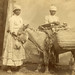 Studio portrait of two African American women with a donkey