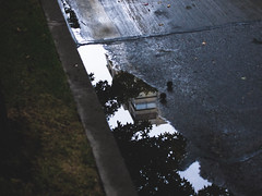 another world (flatlandpics) Tags: street reflection building water pool dark cityscape cloudy ep3
